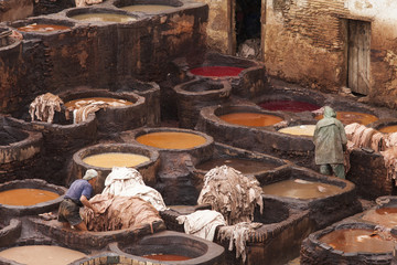 FES, MOROCCO - NOVEMBER 23: Workers at leather factory perform t
