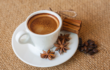 Foto op Canvas koffiebar cup of coffee with cinnamon and beans