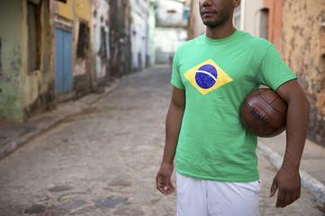 Brazilian Football Player Holding Soccer Ball Street