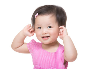 Asian baby girl two hands touch her ear