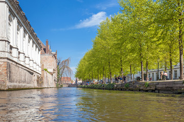 Wall Mural - Low angle view on to the canal of Bruges