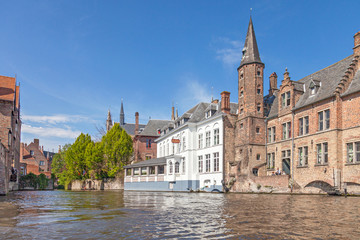 Wall Mural - Ancient red brick building with little tower in Bruges