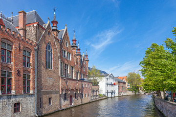 Wall Mural - Canal in Bruges with an ancient red brick building