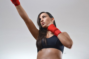 beautiful fitness woman with the red boxing bandage