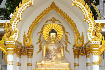 golden buddha statue  in plastic wrapped