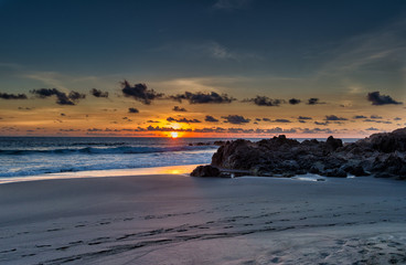 Wild beach at sunset