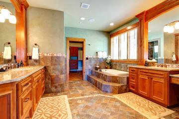 Luxury bathroom with tile wall trim