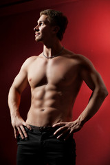 handsome muscular man with a naked torso