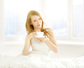 Girl with a cup of morning coffee