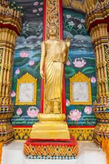 Standing statue of Buddha in Phuket, Thailand