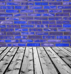 Wooden boards and blue brick wall