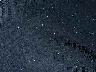 Closeup of dandruff on black trousers