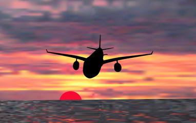 plane at sunset above sea