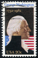 stamp shows George Washington with USA flag