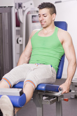 GyM People: Man doing quadriceps exercise