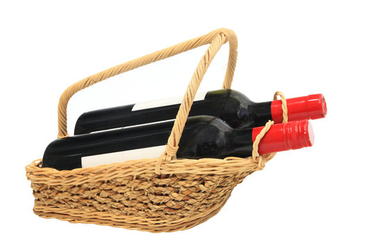 Wine bottles in Picnic basket isolated on white