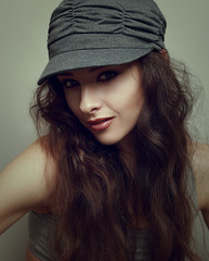 Beautiful woman in cap. Vintage portrait. Hipster style