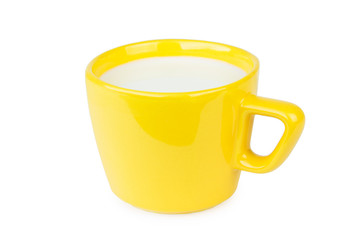 Yellow porcelain cup with milk