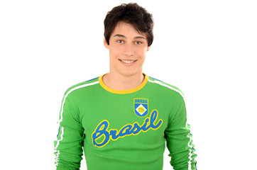 Attractive man with Brasil on his green blouse. Brazilian man.