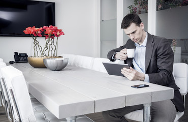 Man using tablet pc at the office in meeting room