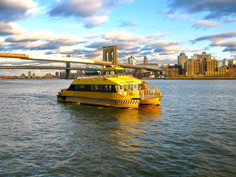 Water Taxi and Brooklyn bridge, seen from Pier 17, at Lower Manh
