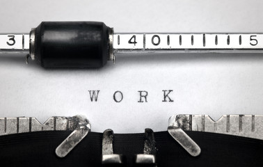 """Work"" written on an old typewriter"