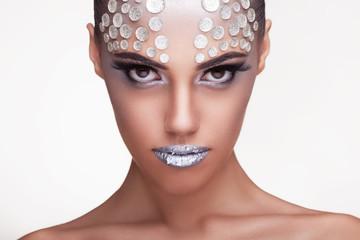 Fashion woman with rinhstone make up