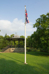 Bandstand and flag in English park.