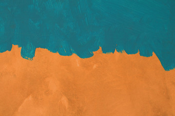 Green painted brush texture on orange cement wall background