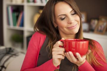 Beautiful woman enjoying the smell of fresh coffee