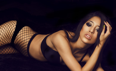 Beautiful woman in fishnet stockings