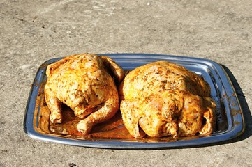 Two roasted chicken on plate