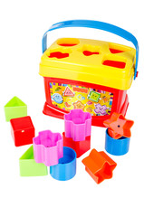 Shape sorter toy with various coloured blocks isolated