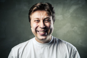 Laughing young man over gray