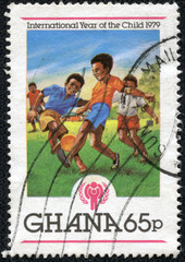 stamp printed in Ghana shows IYC Emblem and Boys playing soccer