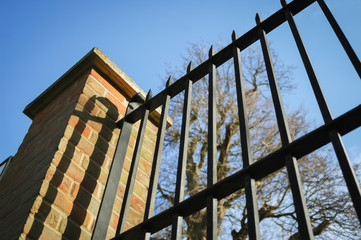 metal railings and brick wall security fence