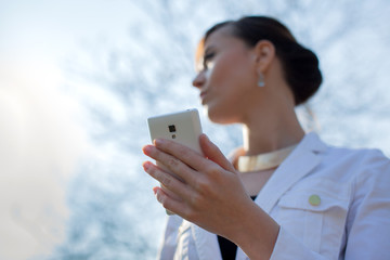 Closeup of woman hands using smartphone