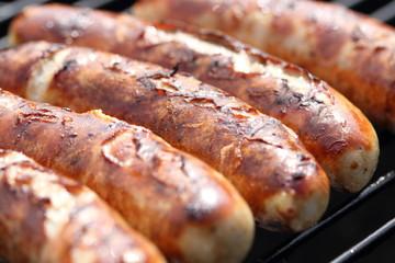 Deurstickers Grill / Barbecue Bratwürstchen
