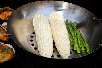 Grilling Corn on the Cob and Fresh Asparagus on a Grill