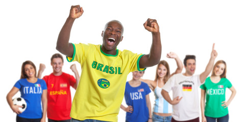 Cheering sports fan from Brazil with fans from other countries