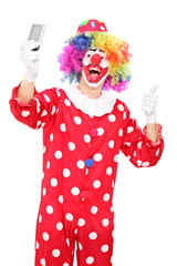 Clown taking selfie with his thumb up