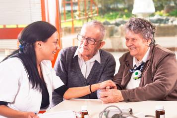 senior couple with a nurse