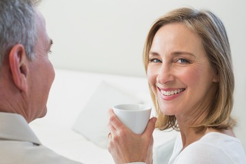 Close-up of a relaxed couple with coffee cup