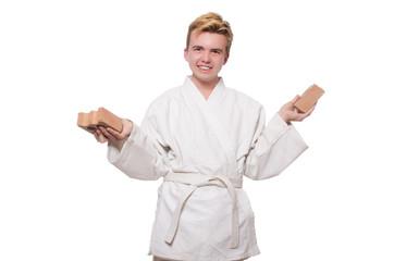 Funny karate man breaking bricks isolated on white
