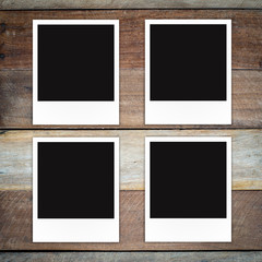Polaroid photo frame on wood background