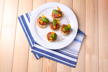 Wall Mural - Tasty canapes with salami, pepper  and basil leaves,