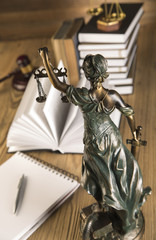 Lady of justice, Wooden & gold gavel and books on table