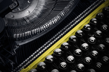 Wall Mural - Old yellow typewriter in shadow