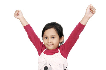 Cute little years girl raises her hands in a victory sign