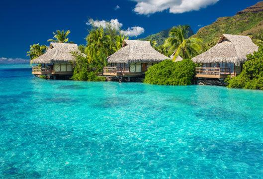Overwater villas in lagoon of Moorea Island
